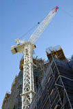 Tall skyscraper high rise building construction with crane. Low angle view Stock Photography