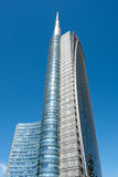 Tall skyscraper with sharp pointed tower in Milan Stock Photography