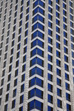 Tall skyscraper windows Royalty Free Stock Image