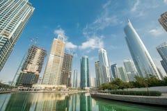 Tall skyscrapers in Dubai near water Stock Image