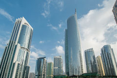 Tall skyscrapers in Dubai near water Stock Photography