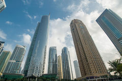 Tall skyscrapers in Dubai near water Royalty Free Stock Image