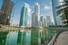 Tall skyscrapers in Dubai near water Stock Photography