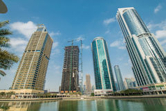 Tall skyscrapers in Dubai near water Stock Images