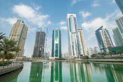 Tall skyscrapers in Dubai near water Stock Photos