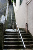 Tall Slippery Wet Stone Steps with Steel Rail Royalty Free Stock Photo
