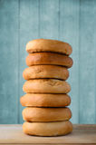 Tall Stack of Bagels on Wood with Turquoise Blue Plank Backgroun Royalty Free Stock Photos