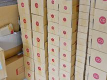 Empty prepared cardboard boxes ready to be filled with goods and shipped to customers. Tall stack of many empty prepared cardboard boxes ready to be filled with stock photo