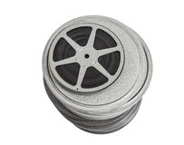 Tall Stack of Vintage Film Cans with a Reel on Top. Stock Photography