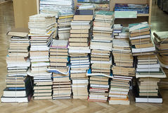 Tall stacks of old books. Several tall stacks of old books royalty free stock photography