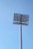 Tall stadium lights with sky Stock Images