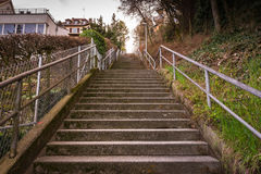 Tall Staircase Never Ending Heaven Sun Flare Sunset Outdoors Hid. Den Rails Old Concrete Top Looking Up from Bottom Perspective stock image
