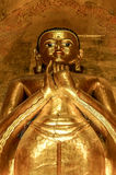 Tall standing golden Buddha showing Dharmachakra Mudra, Gesture Stock Images