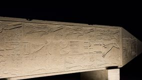Ancient egyptian obelisk on side in Karnak temple at night Royalty Free Stock Photos