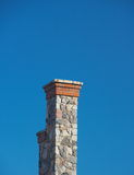 Tall stone chimney against clear deep blue sky 2 Royalty Free Stock Images