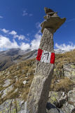 Tall stone marking a hiking trail Royalty Free Stock Photos