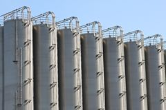 Tall storage tanks Royalty Free Stock Photos