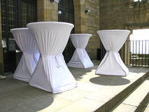 Tall tables with white tablecloths at the reception area Royalty Free Stock Photography