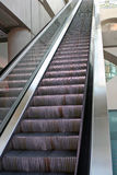 Tall, tall escalator. A very long escalator or moving stairs Stock Photo