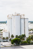 Tall Tanks in Industrial Area Royalty Free Stock Photos