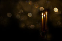 Tall Taper Candles With Golden Bokeh Lights Stock Photos