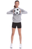 Tall teenage girl soccer player with sports ball Royalty Free Stock Image