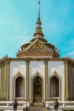 Tall temple. With two statue of knights guarding the doorway Royalty Free Stock Photos