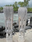 Tall Tiki Statues Overlooking the Beach Royalty Free Stock Photos