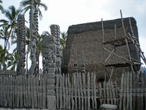 Tall Tiki Statues Overlooking the Beach Stock Images