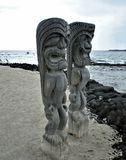 Tall Tiki Statues Overlooking the Beach Royalty Free Stock Photo