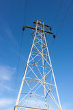 Tall Transmission Tower Against Blue Sky. Tall Steel Transmission Tower Against Blue Sky stock photos