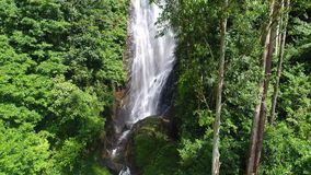 Aerial view of the river that flows down the rocky wooded mountain in Adam`s Peak in Sri Lanka stock footage