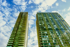 Tall twin buidings. Tall twin buildings with blue sky Royalty Free Stock Photography