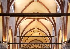 Vaulted ceiling of a church with beams. Tall vaulted ceiling of a church with beams Royalty Free Stock Photo