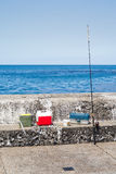 Tall view of fishing equipment on harbor wall Royalty Free Stock Image