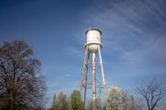 Tall water tower with cloudy blue sky background Stock Photography