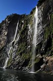 Tall waterfalls in Fiordland NZ Stock Photography