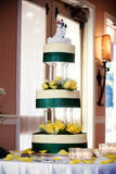 Tall wedding cake. A three level wedding cake with bride and groom figures on top Stock Photography