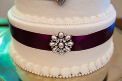 Tall Wedding Cake With Brooches Royalty Free Stock Image