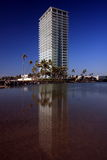 Tall white building. With blue sky background and reflection Stock Photography