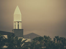 Tall white minaret Stock Image