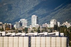 Tall white storage towers on the docks Royalty Free Stock Images