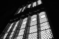 Tall windows, university gothic style. Very tall and ornate windows from the inside of a building in the university gothic style Royalty Free Stock Photography