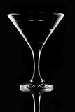 Tall wine glass for a martini. On a black background Royalty Free Stock Image