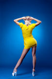 Tall woman show back in yellow dress Royalty Free Stock Photography