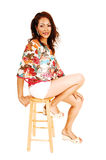 Tall woman sitting. Royalty Free Stock Photography