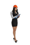 Tall woman with a tablet and a construction helmet royalty free stock photo