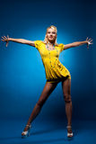 Tall woman in yellow dress pin-up style Royalty Free Stock Images