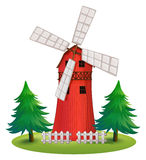 A tall wooden building with a windmill Stock Photo