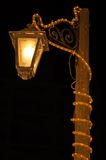 Tall wooden street lamp Royalty Free Stock Photos